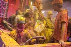 Holi celebration, Vrindavan and Mathura, India. Mathura, India. March 23, 2016. Colourful Holi procession on the streets of Mathura, Uttar Pradesh, India royalty free stock image