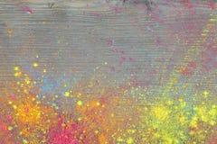 Holi colours on wood Stock Photo