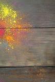 Holi colours on wood Stock Photography