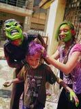 Holi con el hermano y la hermana Fotos de archivo libres de regalías