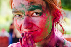 Holi festival celebrations in India. European girl celebrate festival Holi in Delhi, India. Holi, or Holli,is a spring festival celebrated by Hindus, Sikhs and Royalty Free Stock Image