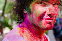 Holi festival celebrations in India. European man celebrate festival Holi in Delhi, India. Holi, or Holli,is a spring festival celebrated by Hindus, Sikhs and Royalty Free Stock Photo