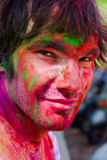 Holi festival celebrations in India. European man celebrate festival Holi in Delhi, India. Holi, or Holli,is a spring festival celebrated by Hindus, Sikhs and Stock Photography