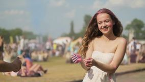 Holi Festival Of Colours. Multi-Ethnic friends celebrate the holi festival, Crazy young people  having fun at Holi festival, cool stock footage