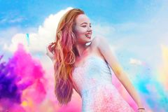 Holi Festival Of Colours. Portrait of happy young pretty girl on holi color festival. Girl with colorful long pink and blue hair s Royalty Free Stock Images