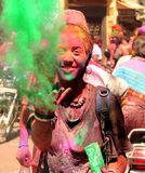 Holi girl. Holi is a festival during whose racial divisions disappear, because all the people are colorful and joyful Royalty Free Stock Photos