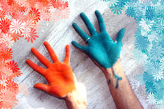 Holi Hands. Hands colored with Holi festival colors, with a floral pattern around stock image