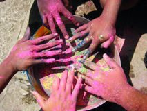 Holi Hands. Hands of people during Holi Festival in India celebrated with different colors Royalty Free Stock Image