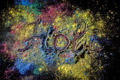 Holi paint festival background with lettering Holi . Color powder explosion on black. Holi paint festival background with lettering Holi . Color powder stock photography