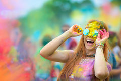 Holi painted girl. Young cheerful woman at Holi paint party stock image