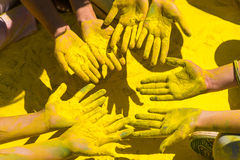Holi painted hands. Couple of yellow colored holi painted hands Royalty Free Stock Photo