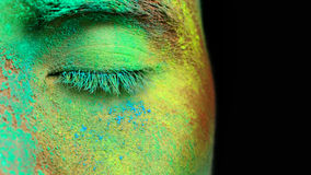 Holi panted face. Part of face fully covered with bright holi paint royalty free stock photos