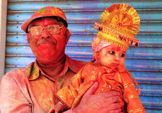 Holi People. Grandfather with granddaughter in traditional guise during Holi Festival in Udaipur Royalty Free Stock Photo