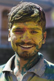 Holi festival in Pushkar, India. Man covered in tika paint during holy festival of Holi in India Royalty Free Stock Photo
