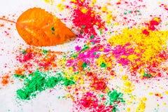 Holi Powder with autumn leaf Stock Photos
