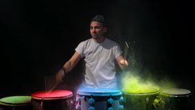 Drummer playing the drum holi powder stock footage