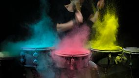 Holi powder bounces off the drum in the form of a shock wave, Close up. Black background stock footage