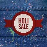 Holi Sale rundabaner med det röda bandet Arkivbild