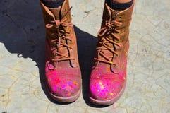 Holi-Schuhe Stockfoto