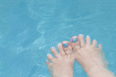 Holiday – Funny feet in the water, fan-shaped toes Royalty Free Stock Photos