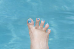 Holiday � Funny foot in the water, fan-shaped toes Royalty Free Stock Photography