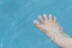 Holiday – Funny foot in the water, fan-shaped toes Royalty Free Stock Photography