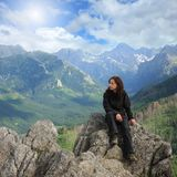 Holiday. Woman on the top of a high mountain royalty free stock photography