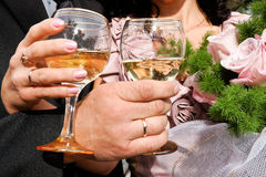 Holiday. Two hands holding glasses of champagne Royalty Free Stock Photos