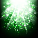 Holiday. Bright abstract explosion with stars over green Stock Image