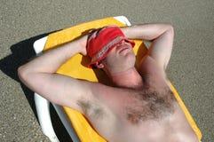 Holiday. Man on the beachl enjoying sunlight Stock Photos