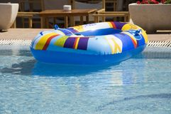 Holiday. An inflatable dinghy floats in a swimming pool Stock Photo