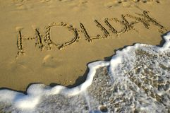 Holiday. Title on the sand of the beach Stock Photography