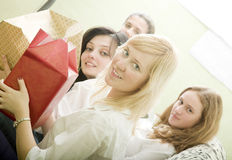 Holiday. Four pretty woman open gift Royalty Free Stock Photo