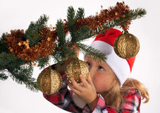 Holiday. Small girl dress up Christmas tree (on light background - not isolated Stock Image