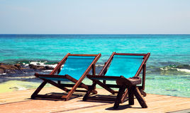 Holiday. On the sea shore are two sunbeds and lie down and feel relaxed beckon Stock Photo