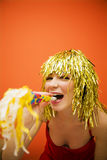 Holiday. Beautiful girl having fun at a carnival party stock photography