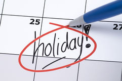 Holiday. It is finally holiday! Marked and written holiday in a calendar Stock Photo