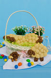 Holiday almond biscuits lamb in a basket. Square Royalty Free Stock Photos