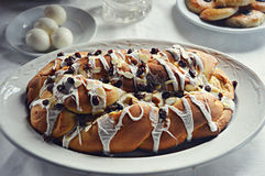 Holiday Almond Raisin Stollen Bread. A beautiful loaf of holiday, Christmas, almond, raisin stollen bread sitting on a white platter with a plate of eggs and Stock Photo
