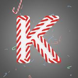 Holiday alphabet letter K uppercase. Christmas font made of mint striped candy canes. 3D render. Xmas typographic symbol from red and white sugar caramels Royalty Free Stock Images
