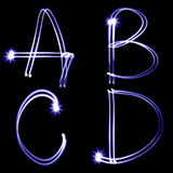 Holiday alphabet. Set of letters created by light Royalty Free Stock Photography