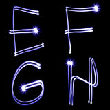 Holiday alphabet. Set of letters created by light Stock Photography
