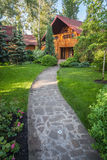 Holiday apartment - wooden cottage in forest Stock Photography
