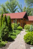 Holiday apartment - wooden cottage in forest Stock Photo