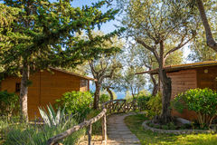 Holiday apartment - wooden cottage in forest near the sea. camping house in Italy Royalty Free Stock Image