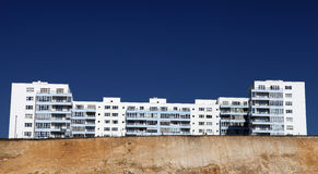 Holiday apartments hotel cliff brighton. Holiday apartments or hotel on top of cliffs in brighton, england. flats with balcony against blue sky Royalty Free Stock Photo
