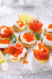 Holiday appetizer with caviar and salmon. Royalty Free Stock Photo