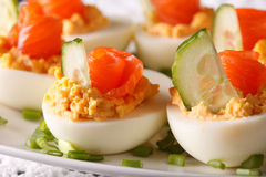 Holiday appetizer: Eggs stuffed with salmon macro. horizontal Royalty Free Stock Image