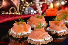 Holiday appetizer with salmon canapes Stock Photos