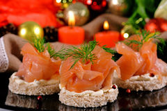Holiday appetizer with salmon canapes Royalty Free Stock Photo